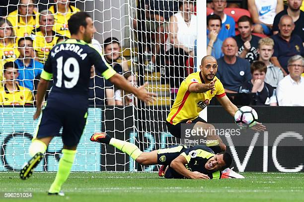 Alexis Sanchez of Arsenal is fouled in the box during the Premier League match between Watford and Arsenal at Vicarage Road on August 27 2016 in...
