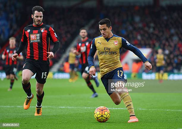Alexis Sanchez of Arsenal is tracked by Adam Smith of Bournemouth during the Barclays Premier League match between AFC Bournemouth and Arsenal at the...