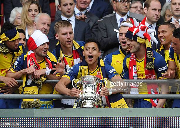 Alexis Sanchez of Arsenal lifts the FA Cup Trophy after the match between Arsenal and Aston Villa in the FA Cup Final at Wembley Stadium on May 30...