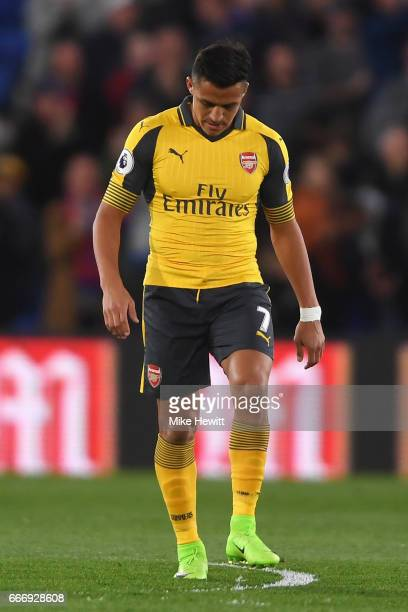 Alexis Sanchez of Arsenal looks dejected as Andros Townsend of Crystal Palace scores their first goal during the Premier League match between Crystal...