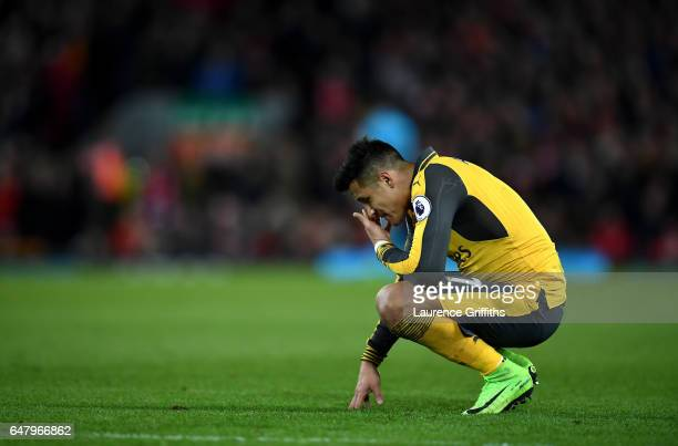 Alexis Sanchez of Arsenal looks dejected during the Premier League match between Liverpool and Arsenal at Anfield on March 4 2017 in Liverpool England