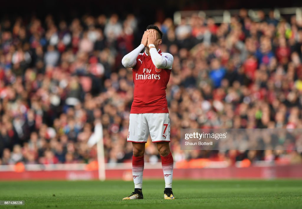 Alexis Sanchez of Arsenal looks dejected during the Premier League match between Arsenal and Swansea City at Emirates Stadium on October 28, 2017 in London, England.