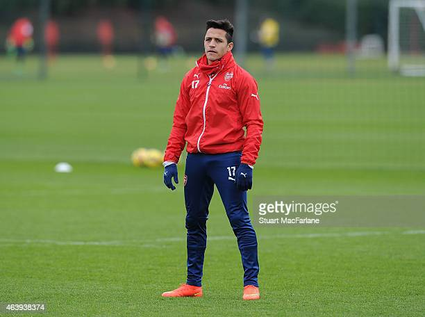 Alexis Sanchez of Arsenal looks on during a training session at London Colney on February 20 2015 in St Albans England
