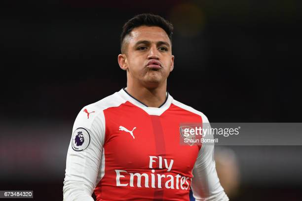 Alexis Sanchez of Arsenal looks on during the Premier League match between Arsenal and Leicester City at the Emirates Stadium on April 26 2017 in...