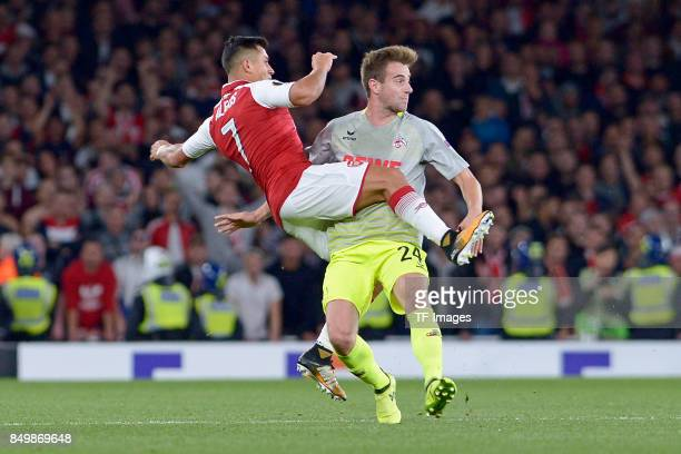Alexis Sanchez of Arsenal Lukas Klünter of Koeln battle for the ball during the UEFA Europa League group H match between Arsenal FC and 1 FC Koeln at...