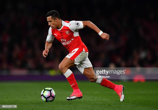 Alexis Sanchez of Arsenal makes a break during the Premier League match between Arsenal and West Ham United at Emirates Stadium on April 5 2017 in...