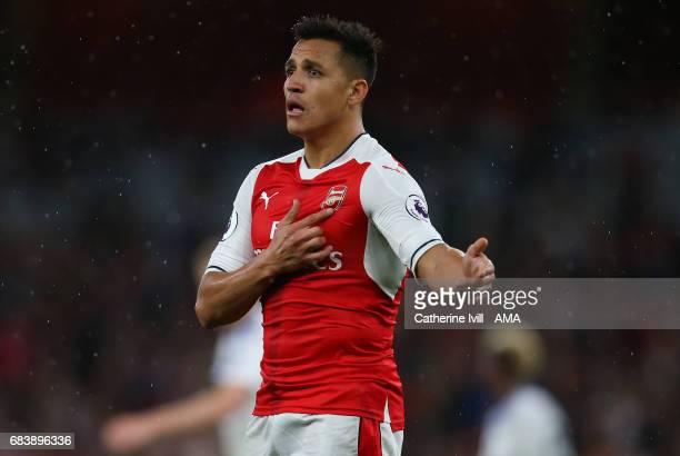 Alexis Sanchez of Arsenal points the badge on his chest during the Premier League match between Arsenal and Sunderland at Emirates Stadium on May 16...
