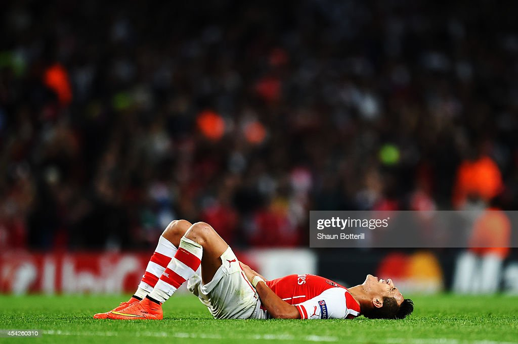 Alexis Sanchez of Arsenal reacts at the end of the UEFA Champions League Qualifier 2nd leg match between Arsenal and Besiktas at the Emirates Stadium on August 27, 2014 in London, United Kingdom.