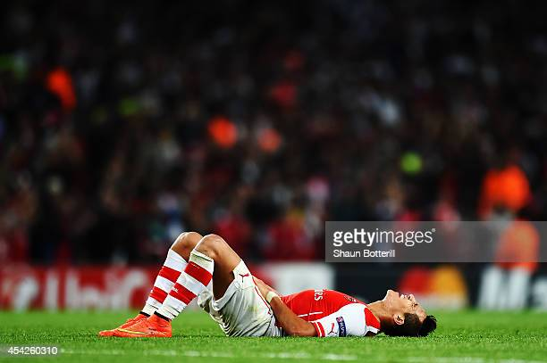 Alexis Sanchez of Arsenal reacts at the end of the UEFA Champions League Qualifier 2nd leg match between Arsenal and Besiktas at the Emirates Stadium...