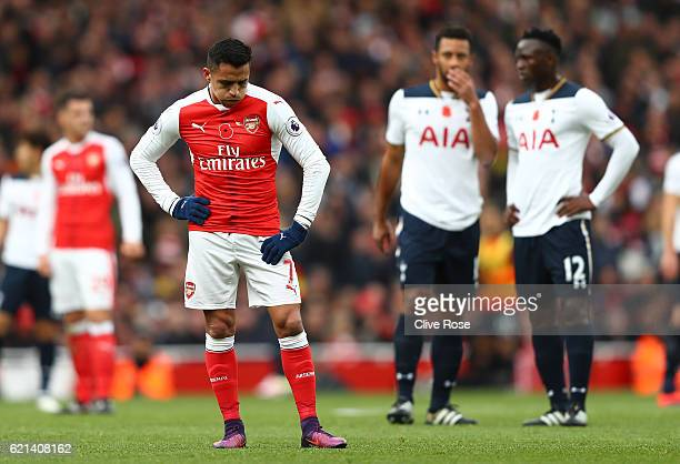 Alexis Sanchez of Arsenal reacts during the Premier League match between Arsenal and Tottenham Hotspur at Emirates Stadium on November 6 2016 in...