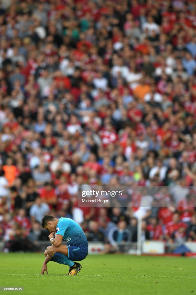 Alexis Sanchez of Arsenal reacts during the Premier League match between Liverpool and Arsenal at Anfield on August 27, 2017 in Liverpool, England.
