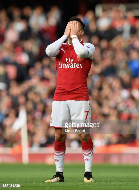 Alexis Sanchez of Arsenal reacts during the Premier League match between Arsenal and Swansea City at Emirates Stadium on October 28 2017 in London...