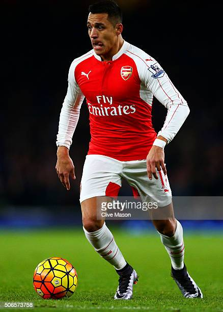 Alexis Sanchez of Arsenal runs with the ball during the Barclays Premier League match between Arsenal and Chelsea at Emirates Stadium on January 24...