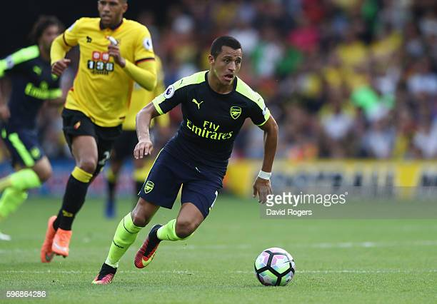 Alexis Sanchez of Arsenal runs with the ball during the Premier League match between Watford and Arsenal at Vicarage Road on August 27 2016 in...