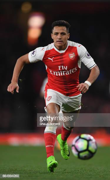 Alexis Sanchez of Arsenal runs with the ball during the Premier League match between Arsenal and West Ham United at Emirates Stadium on April 5 2017...