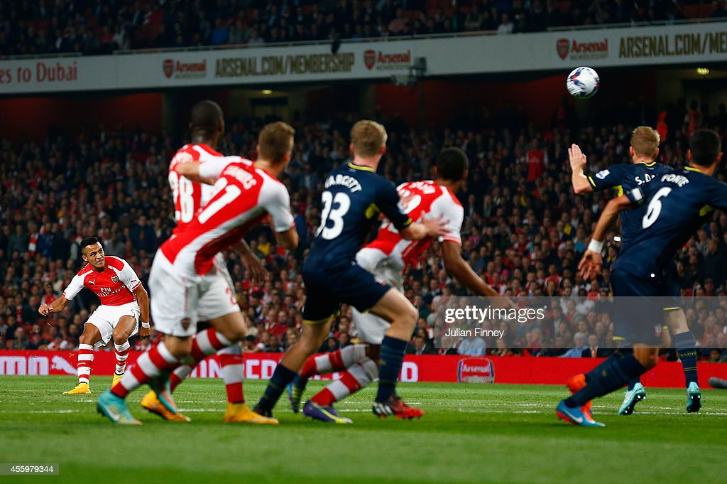 Alexis Sanchez of Arsenal scores a free kick to make it 1-0 during the Capital One Cup Third Round match between Arsenal and Southampton at the Emirates Stadium on September 23, 2014 in London, England.
