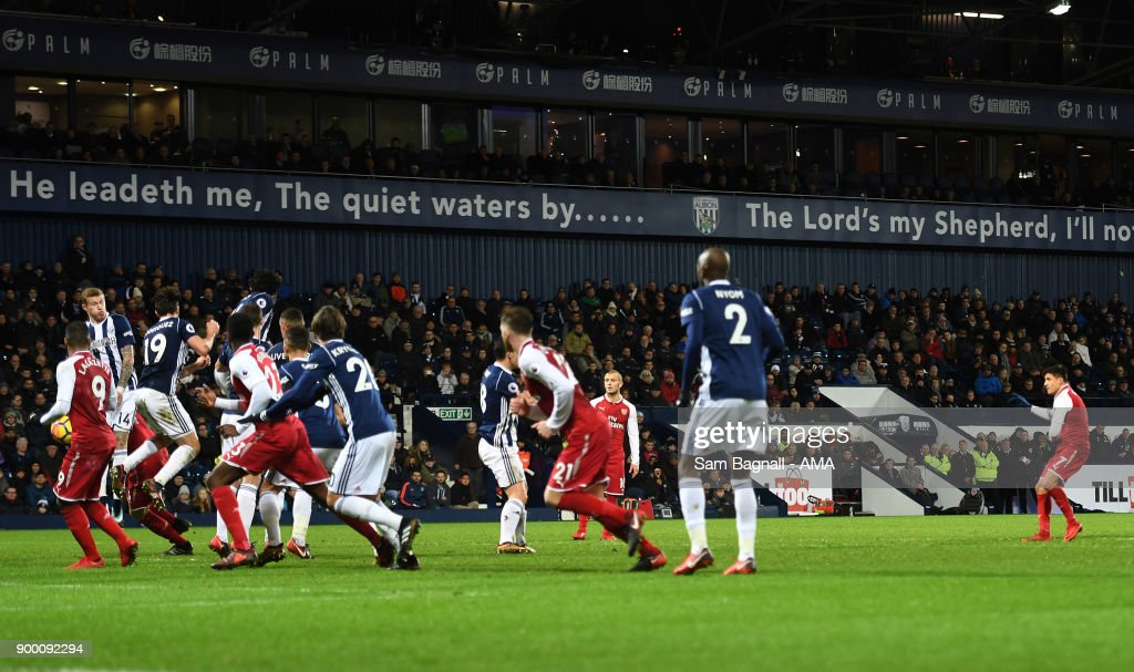 Alexis Sanchez of Arsenal scores a goal to make it 0-1 during the Premier League match between West Bromwich Albion and Arsenal at The Hawthorns on December 31, 2017 in West Bromwich, England.