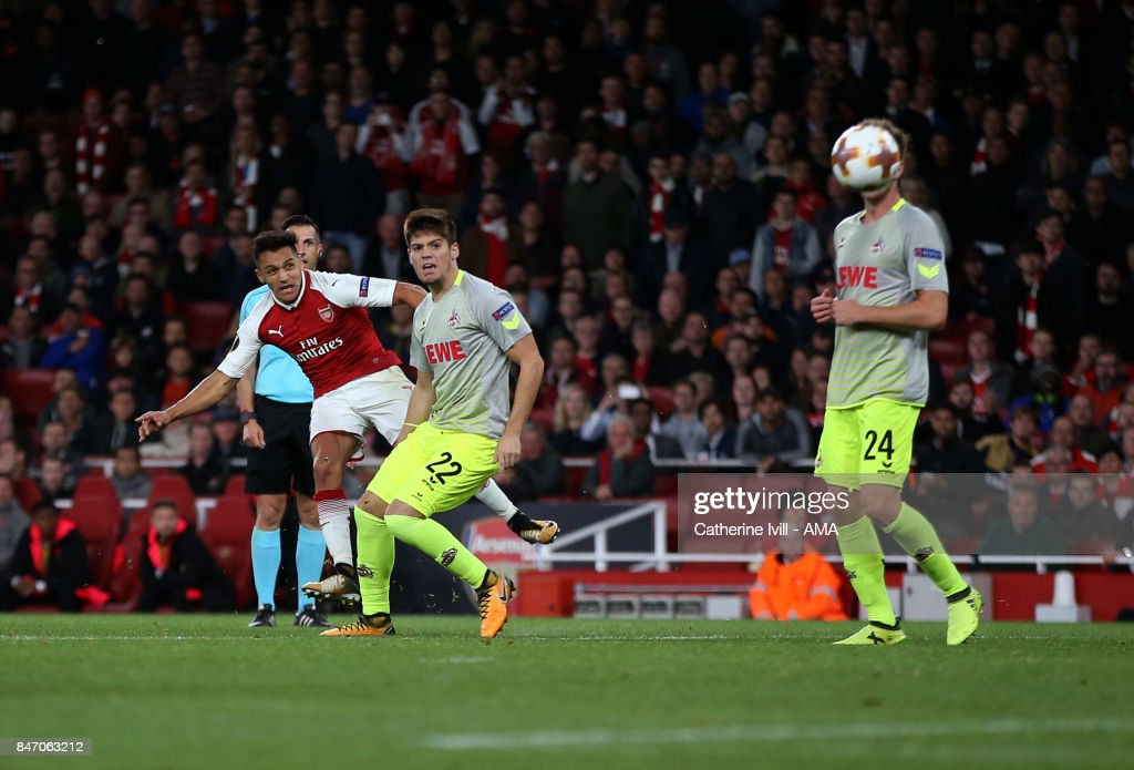 Alexis Sanchez of Arsenal scores a goal to make it 2-1 during the UEFA Europa League group H match between Arsenal FC and 1. FC Koeln at Emirates Stadium on September 14, 2017 in London, United Kingdom.