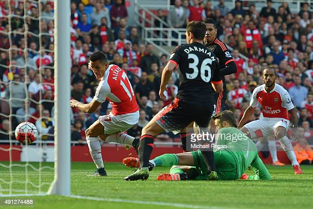 Alexis Sanchez of Arsenal scores Arsenal's first goal during the Barclays Premier League match between Arsenal and Manchester United at Emirates...