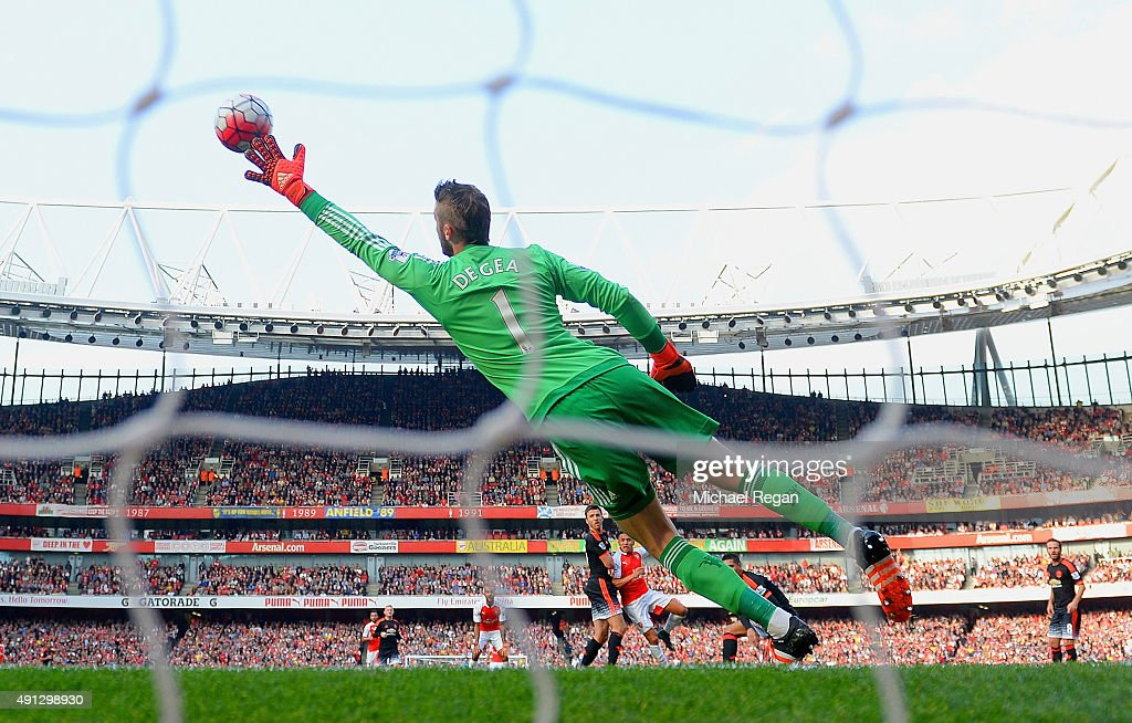 Alexis Sanchez of Arsenal scores Arsenal's third goal past the outstretched David De Gea of Manchester United during the Barclays Premier League match between Arsenal and Manchester United at Emirates Stadium on October 4, 2015 in London, England.