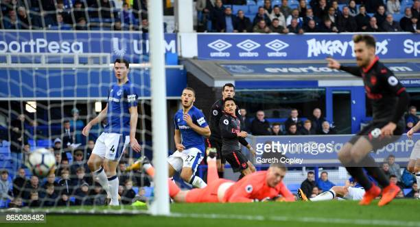 Alexis Sanchez of Arsenal scores his sides fifth goal during the Premier League match between Everton and Arsenal at Goodison Park on October 22 2017...