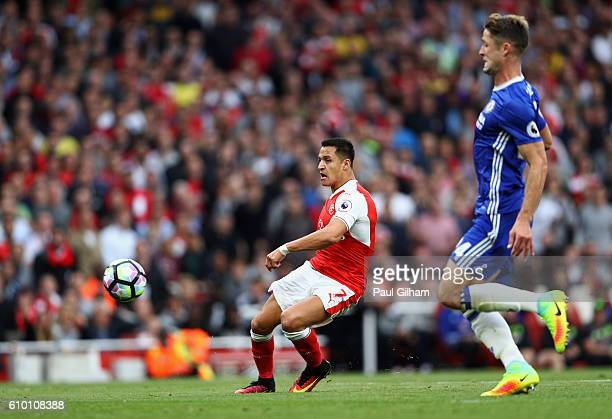 Alexis Sanchez of Arsenal scores his sides first goal during the Premier League match between Arsenal and Chelsea at the Emirates Stadium on...