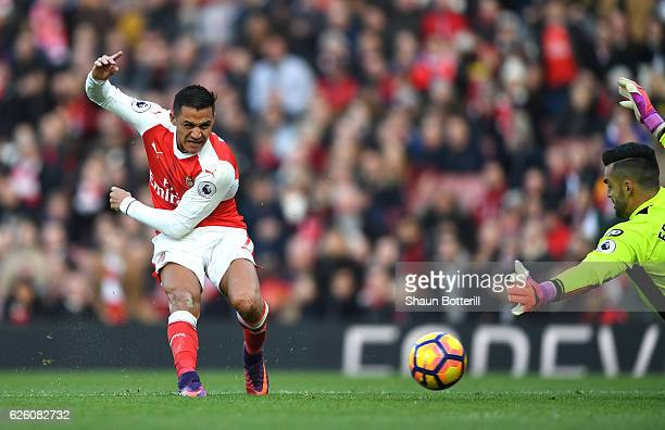 Alexis Sanchez of Arsenal scores his sides first goal during the Premier League match between Arsenal and AFC Bournemouth at Emirates Stadium on...