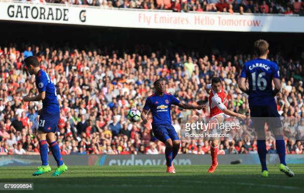 Alexis Sanchez of Arsenal scores his sides first goal during the Premier League match between Arsenal and Manchester United at the Emirates Stadium...