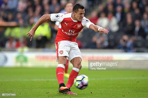 Alexis Sanchez of Arsenal scores his sides second goall during the Premier League match between Hull City and Arsenal at KCOM Stadium on September 17...
