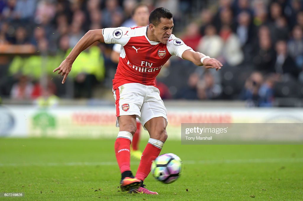 Alexis Sanchez of Arsenal scores his sides third goal during the Premier League match between Hull City and Arsenal at KCOM Stadium on September 17, 2016 in Hull, England.