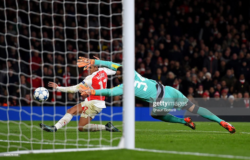 Alexis Sanchez of Arsenal scores his side's third goal past Eduardo of Dinamo Zagreb during the UEFA Champions League match between Arsenal FC and GNK Dinamo Zagreb at Emirates Stadium on November 24, 2015 in London, United Kingdom.