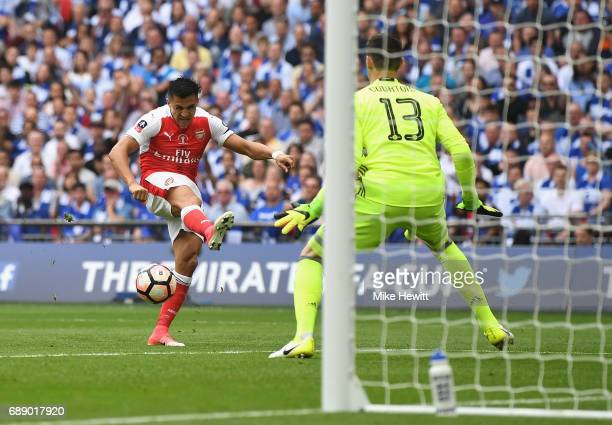 Alexis Sanchez of Arsenal scores his teams first goal during The Emirates FA Cup Final between Arsenal and Chelsea at Wembley Stadium on May 27 2017...