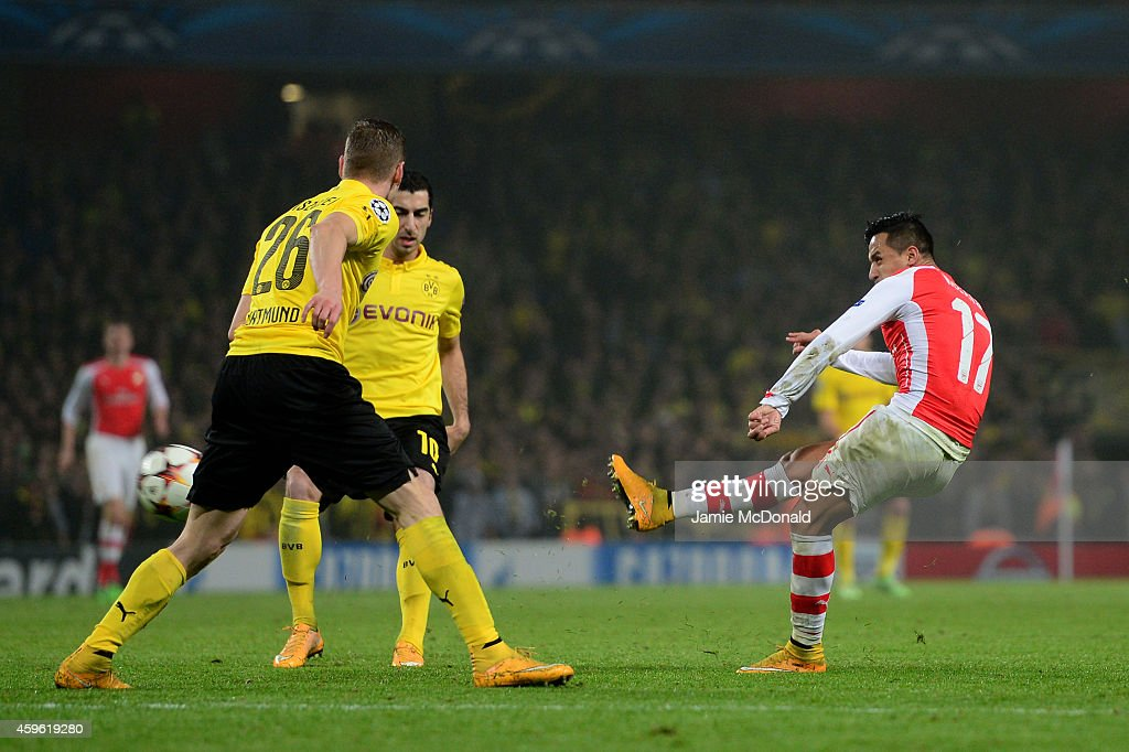 Alexis Sanchez of Arsenal scores his team's second goal during the UEFA Champions League Group D match between Arsenal and Borussia Dortmund at the Emirates Stadium on November 26, 2014 in London, United Kingdom.