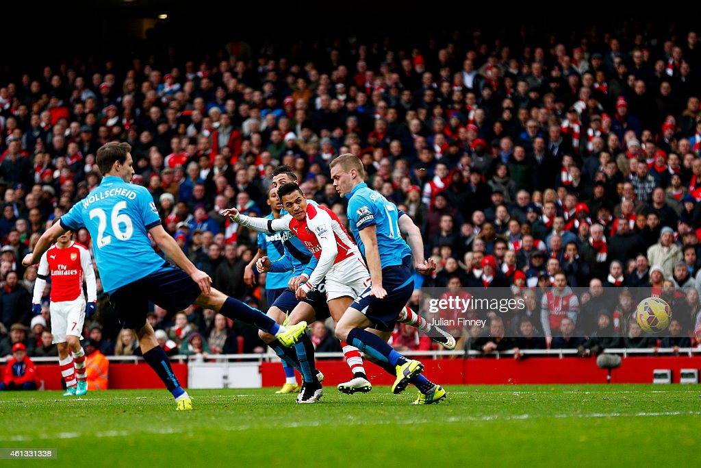 Alexis Sanchez of Arsenal scores his team's second goal during the Barclays Premier League match between Arsenal and Stoke City at Emirates Stadium on January 11, 2015 in London, England.