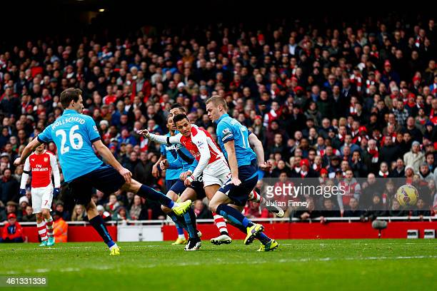 Alexis Sanchez of Arsenal scores his team's second goal during the Barclays Premier League match between Arsenal and Stoke City at Emirates Stadium...