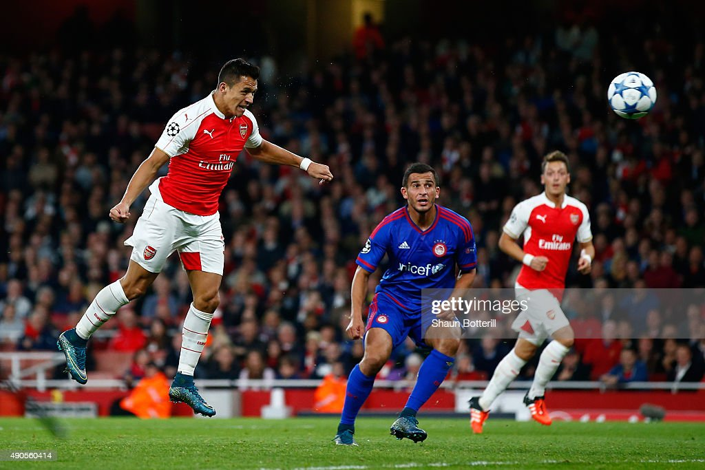 Alexis Sanchez of Arsenal scores his teams second goal with a header during the UEFA Champions League Group F match between Arsenal FC and Olympiacos FC at the Emirates Stadium on September 29, 2015 in London, United Kingdom.