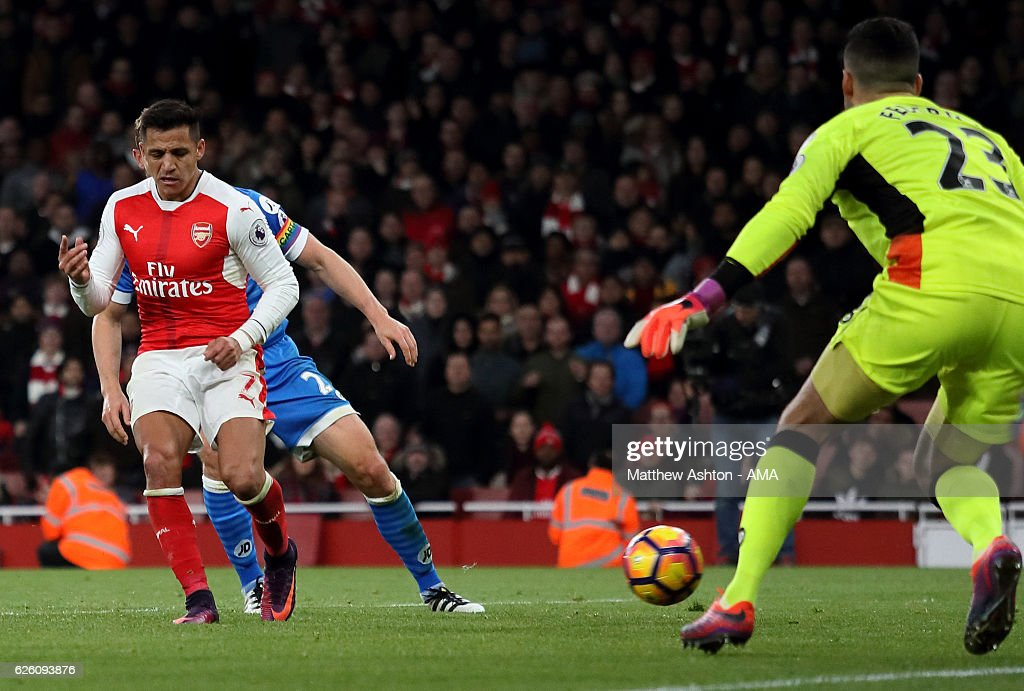 Alexis Sanchez of Arsenal scores his team's third goal during the Premier League match between Arsenal and AFC Bournemouth at Emirates Stadium on November 27, 2016 in London, England.