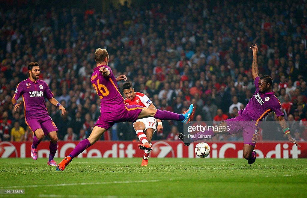 Alexis Sanchez of Arsenal scores his team's third goal during the UEFA Champions League group D match between Arsenal FC and Galatasaray AS at Emirates Stadium on October 1, 2014 in London, United Kingdom.