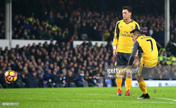 Alexis Sanchez of Arsenal scores the opening goal from a free kick during the Premier League match between Everton and Arsenal at Goodison Park on...