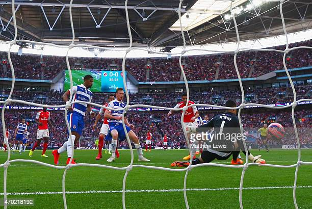 Alexis Sanchez of Arsenal scores the opening goal past goalkeeper Adam Federici of Reading during the FA Cup Semi Final between Arsenal and Reading...