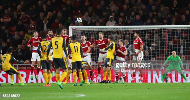 Alexis Sanchez of Arsenal scores their first goal from a free kick during the Premier League match between Middlesbrough and Arsenal at Riverside...