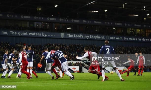 Alexis Sanchez of Arsenal scores their first goal from a free kick during the Premier League match between West Bromwich Albion and Arsenal at The...