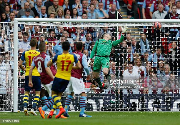 Alexis Sanchez of Arsenal scores their second goal past goalkeeper Shay Given of Aston Villa during the FA Cup Final between Aston Villa and Arsenal...