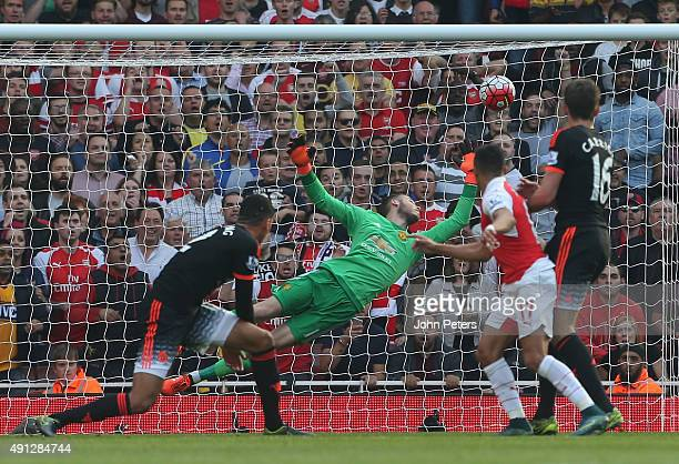Alexis Sanchez of Arsenal scores their third goal during the Barclays Premier League match between Arsenal and Manchester United at Emirates Stadium...