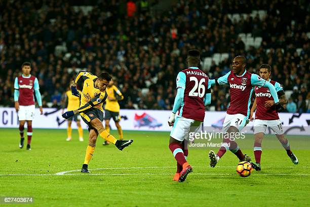 Alexis Sanchez of Arsenal scores their third goal during the Premier League match between West Ham United and Arsenal at London Stadium on December 3...