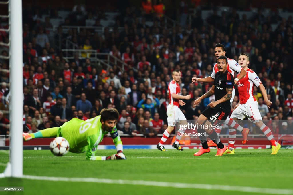 Alexis Sanchez (2nd right) of Arsenal shoots and scores past Tolga Zengin the Besiktas goalkeeper during the UEFA Champions League Qualifier 2nd leg match between Arsenal and Besiktas at the Emirates Stadium on August 27, 2014 in London, United Kingdom.