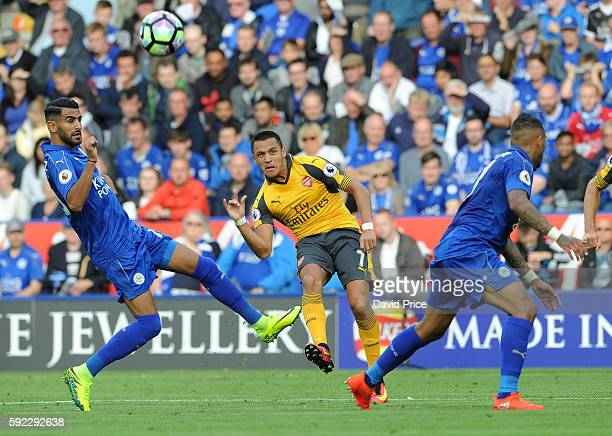 Alexis Sanchez of Arsenal shoots under pressure from Riyad Mahrez of Leicester during the Premier League match between Leicester City and Arsenal at...