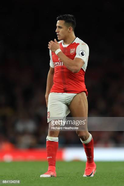 Alexis Sanchez of Arsenal shows off a stud mark on his leg during the Premier League match between Arsenal and Sunderland at Emirates Stadium on May...