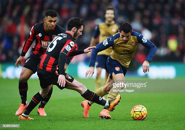 Alexis Sanchez of Arsenal takes on Adam Smith and Joshua King of Bournemouth during the Barclays Premier League match between AFC Bournemouth and...