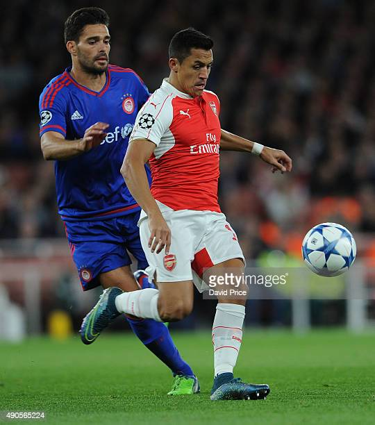 Alexis Sanchez of Arsenal takes on Alberto Botia of Olympiacos during the match between Arsenal and Olympiacos on September 29 2015 in London United...